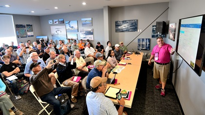 "Gary Reeves presents a ground school workshop, ""IFR Refresher and Pro Tips,"" during AOPA's Livermore Fly-In. One in three fly-in visitors attended a seminar or workshop session. Photo by Mike Collins."