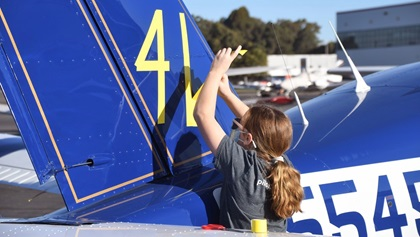 Tape is used to temporarily apply race number 41 to the Socata TB20 Trinidad flown by Michael and Elisa Coyle in the 2020 Hayward Air Rally. The first-time participants landed in eighth place. Photo by Carl La Rue.