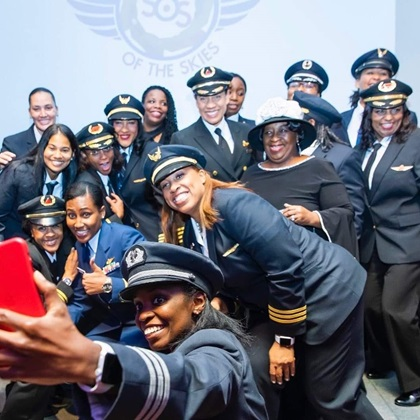 "Sisters of the Skies is a national organization for ""women of color cultivating and promoting minority women in the aviation industry through scholarship, mentorship, and most of all emotional support."" Photo courtesy of Lt. Christine Hughes, U.S. Coast Guard."