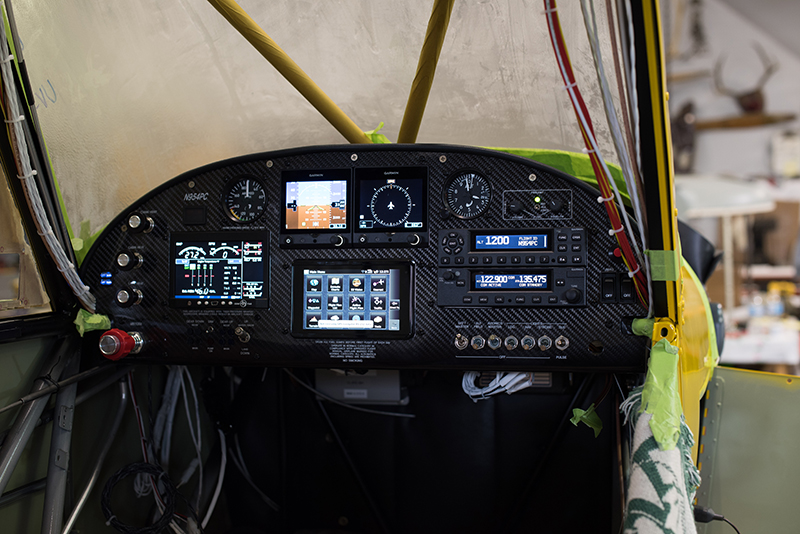Garmin's two G5s, aera 660, and J.P. Instruments EDM 900 shine all powered up in the Sweepstakes Super Cub's instrument panel. Photo courtesy of Aerotronics.