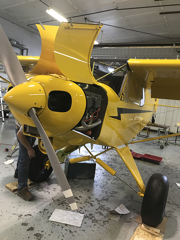 AOPA's Sweepstakes Super Cub thinks thin and prepares for being weighed.