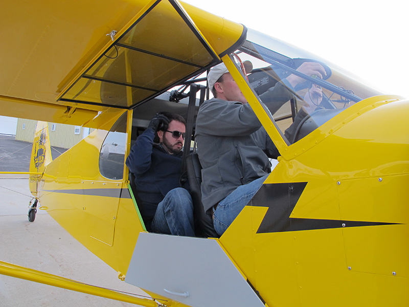 Aerotronics technician Isaac Horn climbs aboard the Super Cub with Baker Air Service's Darin Meggers to fine tune the avionics on a second test flight April 6.