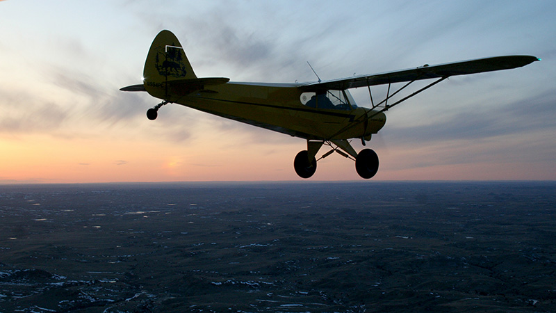 Baker Air Service's Darin Meggers has some fun during the second test flight of the Super Cub at sunset on April 6.