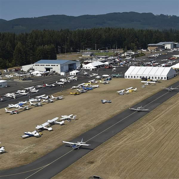 Aviation enthusiasts set an AOPA regional fly-in record by flying 690 aircraft and driving 1,064 automobiles to Bremerton National Airport for the AOPA Fly-In at Bremerton, Washington, Aug. 20. Photo by David Tulis.