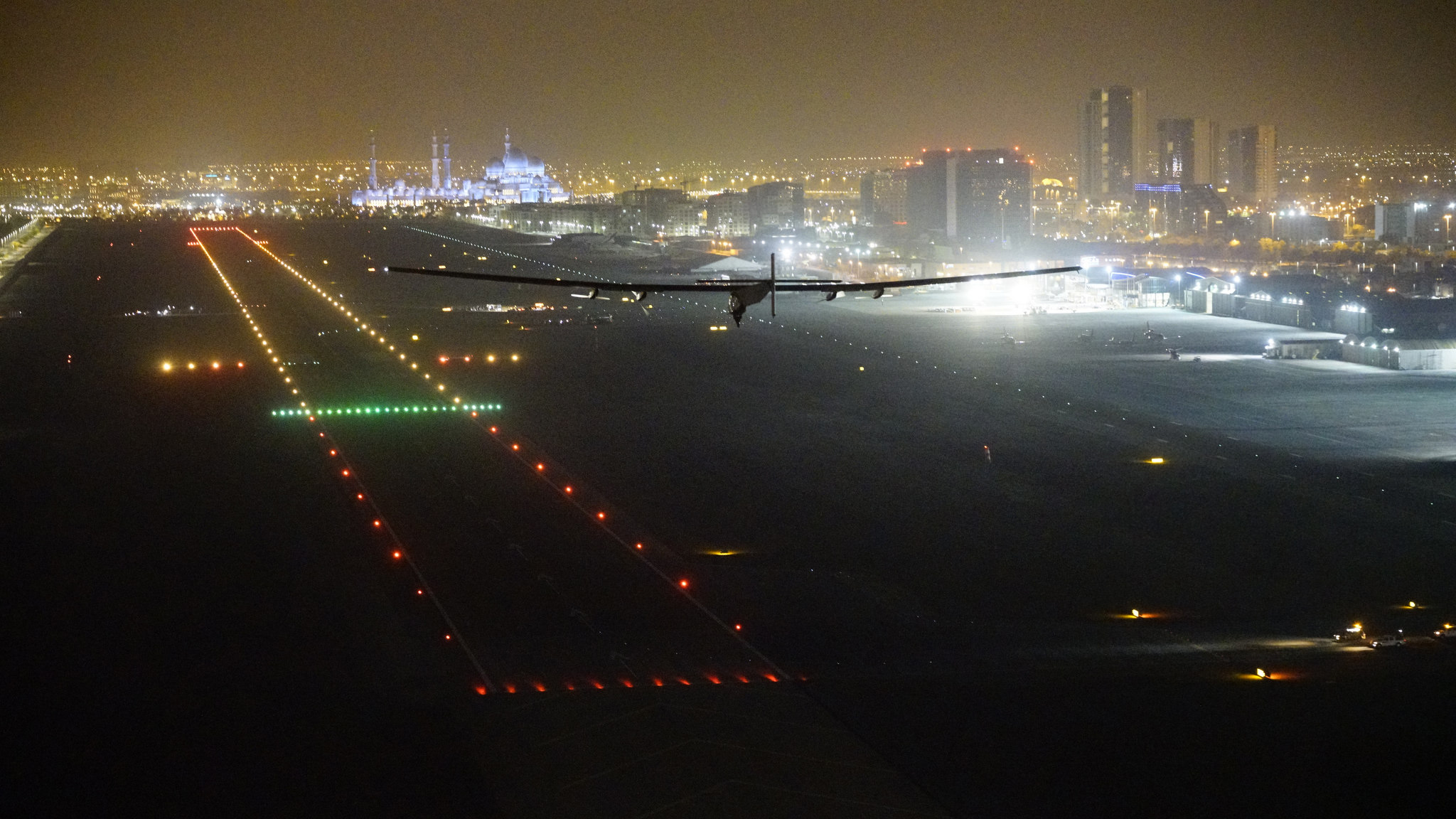 Solar Impulse 2 approaches to land in Abu Dhabi, concluding its round-the-world solar-powered flight. Photo courtesy of Solar Impulse.