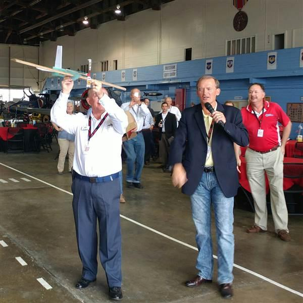 Piper CEO Simon Caldecott throws his team's entry into the airplane build competition during the annual Redbird Migration educational conference for flight training professionals, in San Marcos, Texas. Photo by Ian Twombly.
