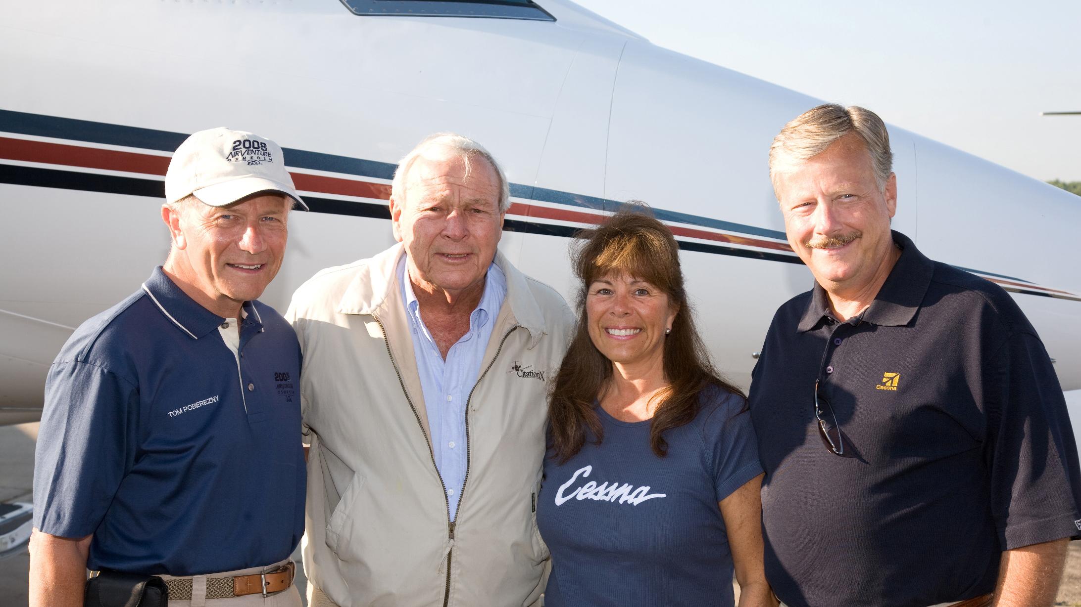 Golfing great Arnold Palmer joins former EAA president Tom Poberezny and Rose and Jack Pelton at the 2008 EAA AirVenture in Oshkosh. Pelton, the current Experimental Aircraft Association CEO and president, cemented a long friendship with Palmer when Pelton was the CEO of Cessna Aircraft. Photo courtesy of EAA.