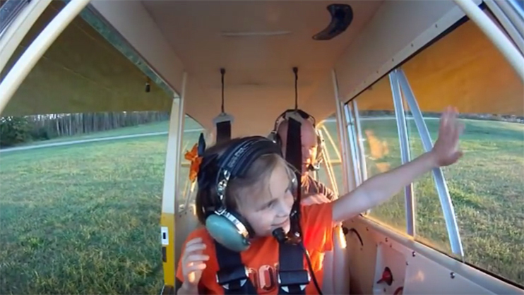 Lainey gets her first flight. Share an experience like this on National Aviation Day.