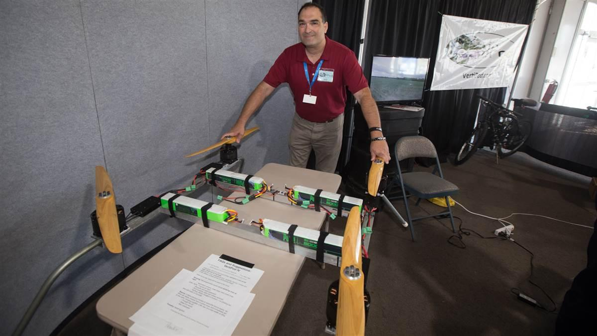 Pete Bitar, founder of the Indiana company AirBuoyant and inventor of the VertiPod quadcopter made for heavy lifting, said he scarcely got a chance to sit during the week of EAA AirVenture, with so many visitors to the company display. Jim Moore photo.