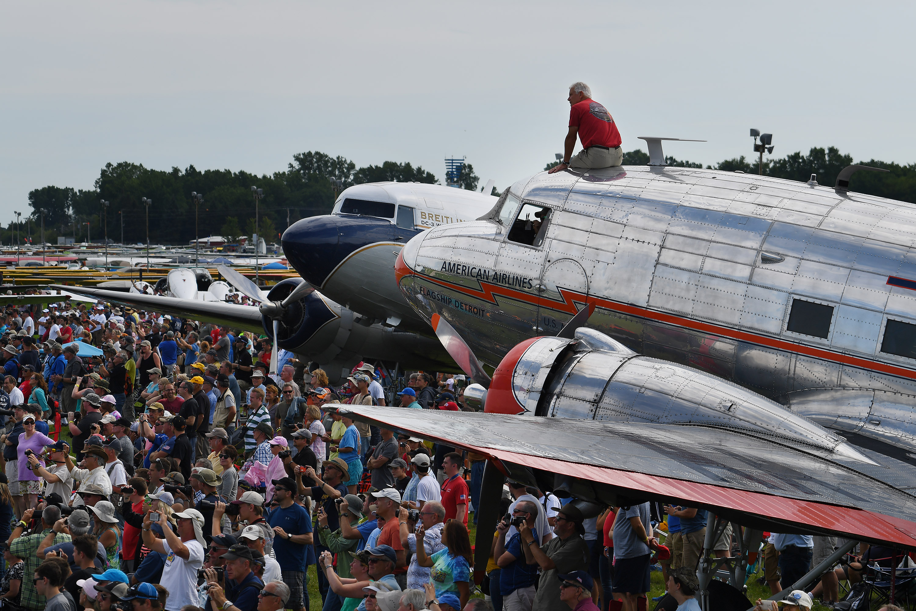 Large crowds gather near DC-3s to watch the afternoon airshow at EAA AirVenture in Oshkosh, Wisconsin, July 25. Photo by David Tulis.