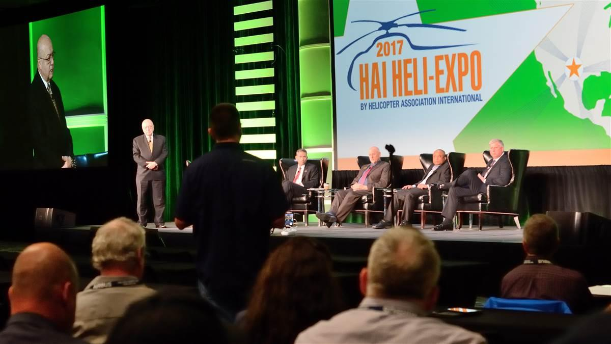 Helicopter Association International (HAI) President Matt Zuccaro, left, and panelists listen to an audience member's question during HAI's symposium on integrating unmanned aircraft systems into the National Airspace System on the opening day of Heli-Expo 2017. Photo by Mike Collins.