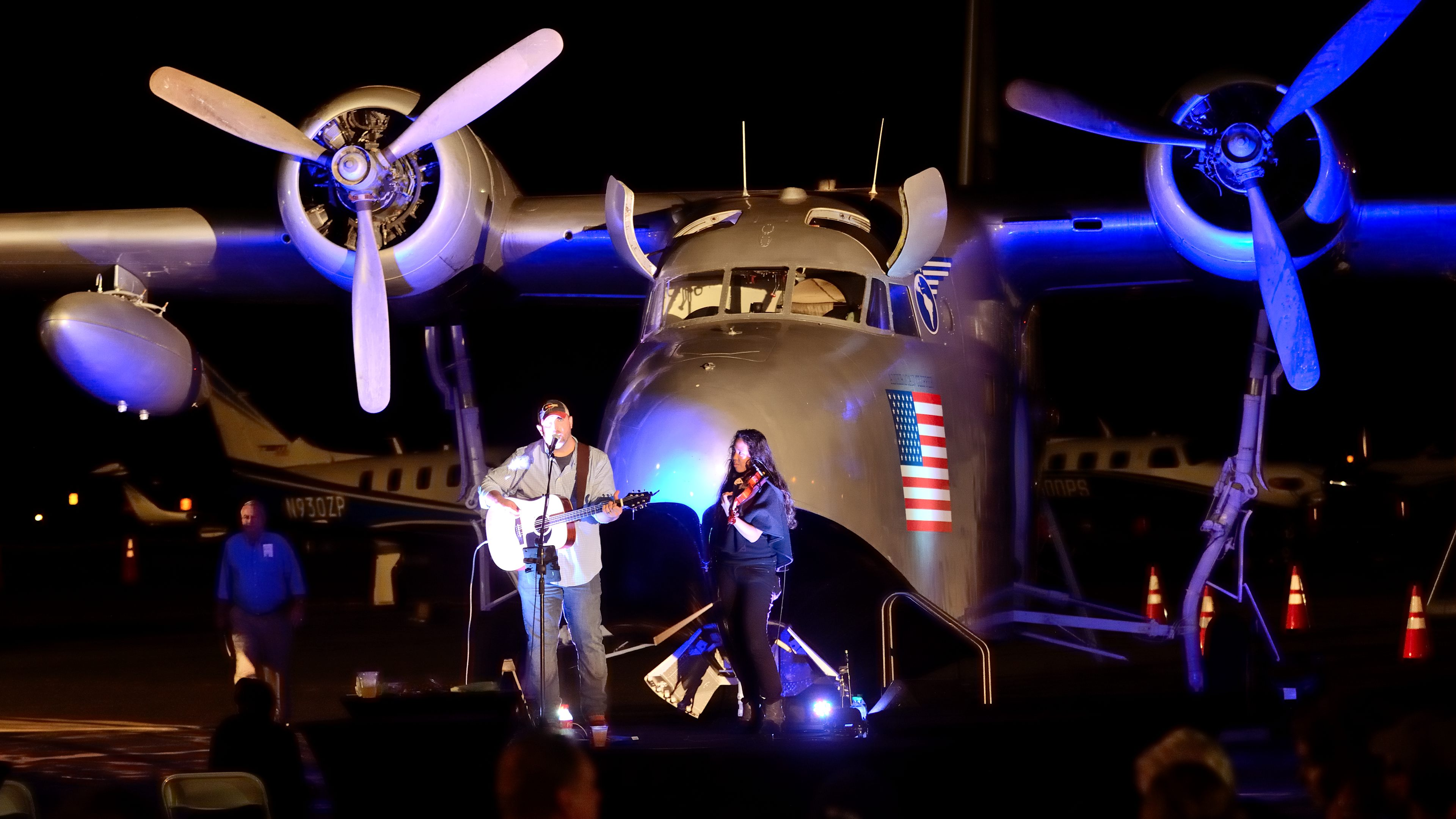 Entertainment for the Barnstormers Party at AOPA's 2017 Groton Fly-In, the Jonathan Moody Band, takes the stage--strategically positioned in front of a restored Grumman Albatross. Photo by Mike Collins.