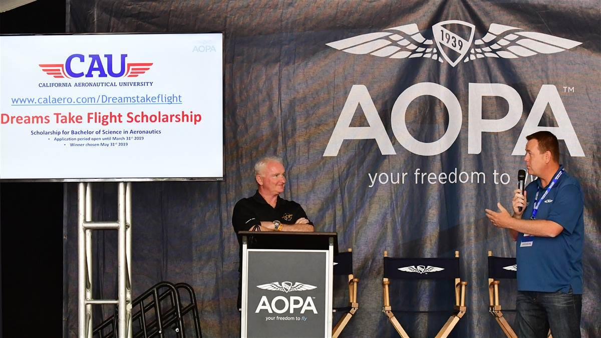 AOPA President Mark Baker and California Aeronautical University President Matt Johnston announce a scholarship initiative during the Sun 'n Fun International Fly-In and Expo in Lakeland, Florida, April 11, 2018. Photo by David Tulis.