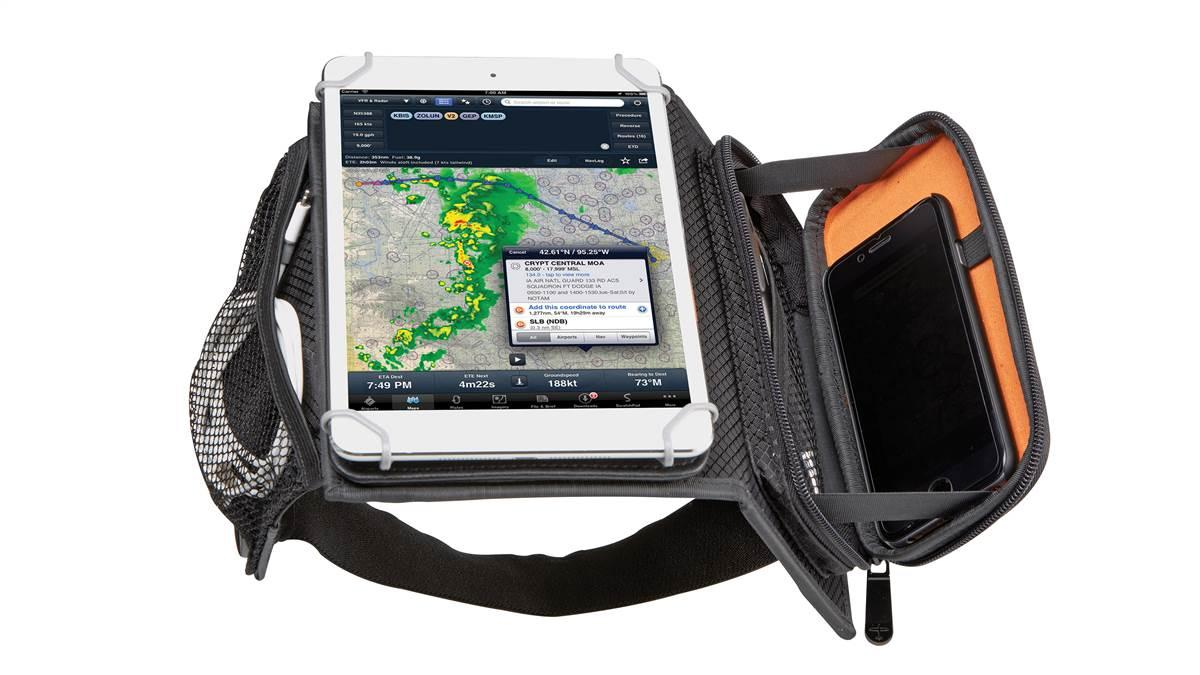 Flight Outfitters designed the iPad Mini Kneeboard with a turntable that allows vertical or horizontal viewing, a side notepad pocket desk, and an accessory pouch for charging cords, sunglasses, or other small items. Photo courtesy of Flight Outfitters.