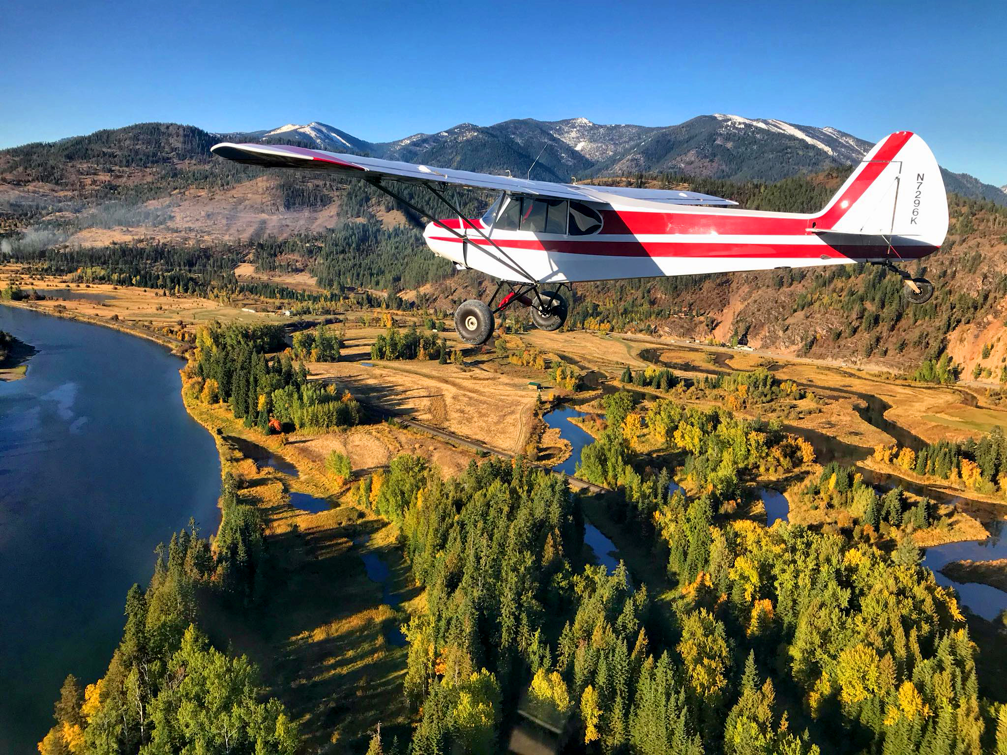At the easternmost point of Lake Pend Orielle, CFI Lisa Martin heads south over the Clark Fork Delta in her PA18-150 Super Cub. Photo by Amber Phillips.