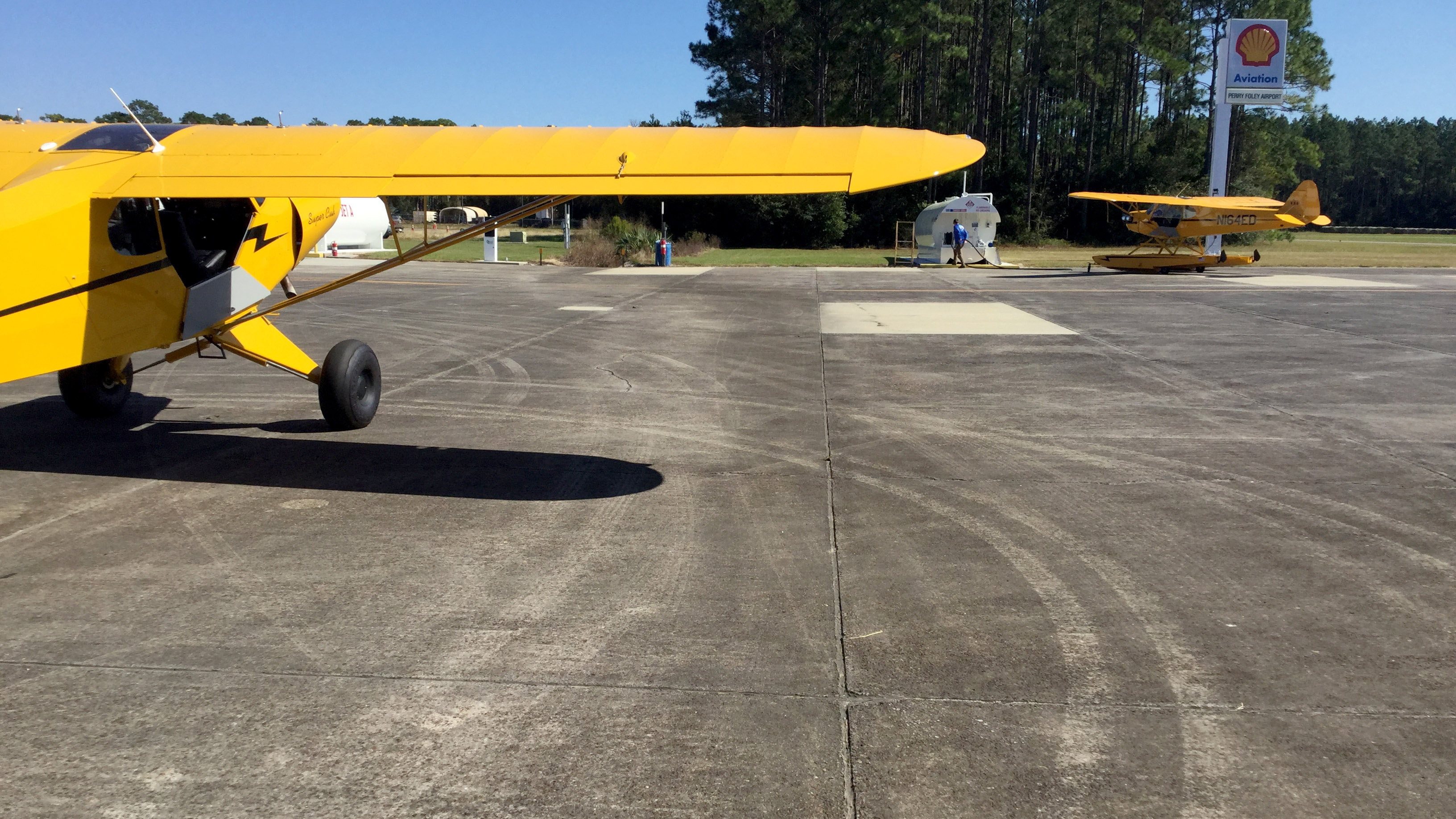 Cheap avgas at Perry-Foley Airport in Perry, Florida, attracts birds of a similar feather: The AOPA Sweepstakes Super Cub and a Cub on floats.