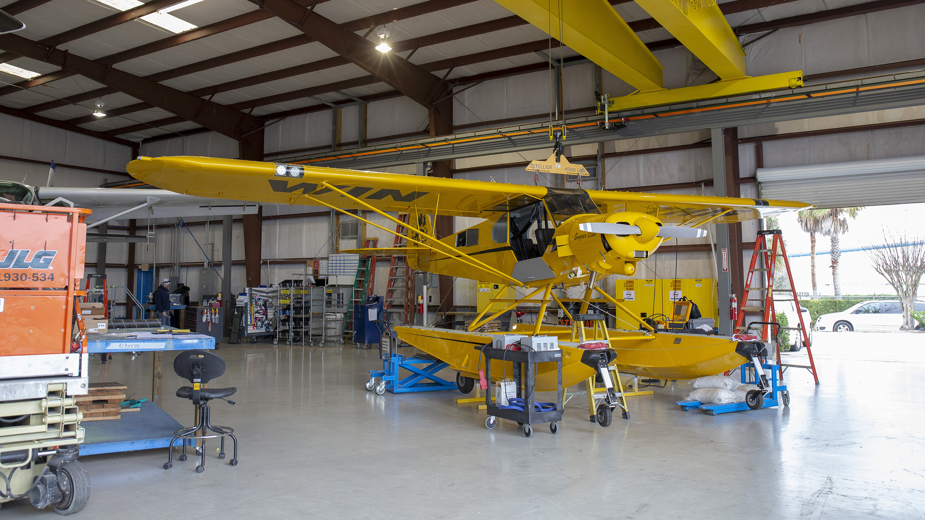 It's not every day you see an airplane suspended in a hangar, unless you work at Wipaire's Leesburg, Florida, facility where they install floats on aircraft. Wipaire installed its Wipline 2100 amphibious floats on the AOPA Sweepstakes Super Cub.