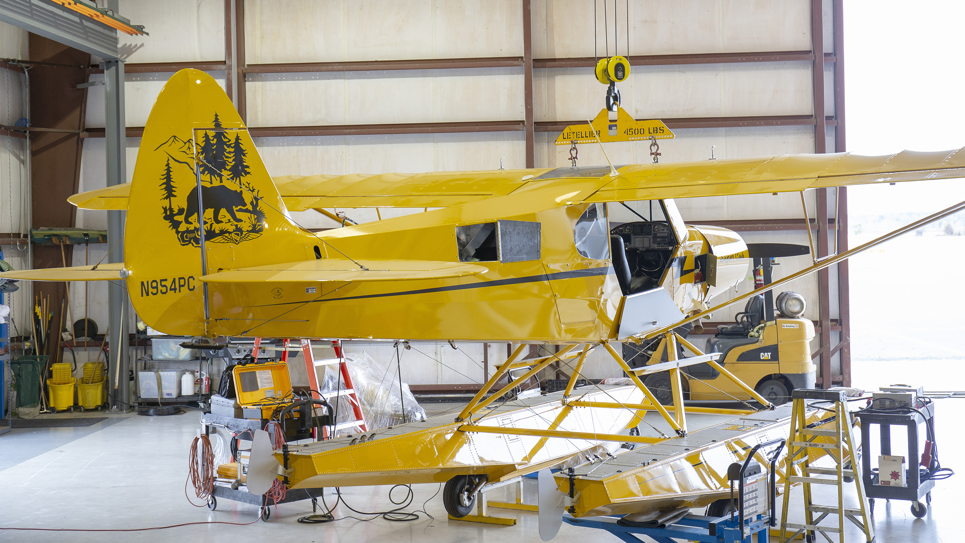 The Wipline 2100 amphibious floats match the Super Cub's Lock Haven Yellow paint perfectly because Wipaire scanned the airplane this summer to ensure a flawless match.