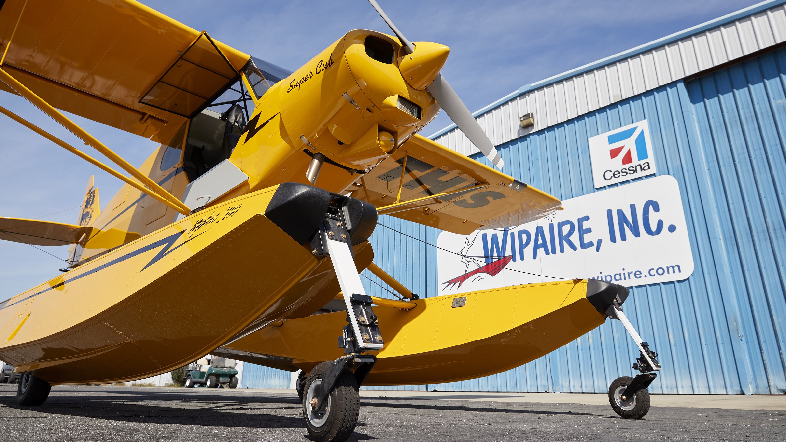 Fresh out of the shop with its sea legs, the Sweepstakes Super Cub shines in the Florida sunlight on Wipaire's ramp at Leesburg International Airport.
