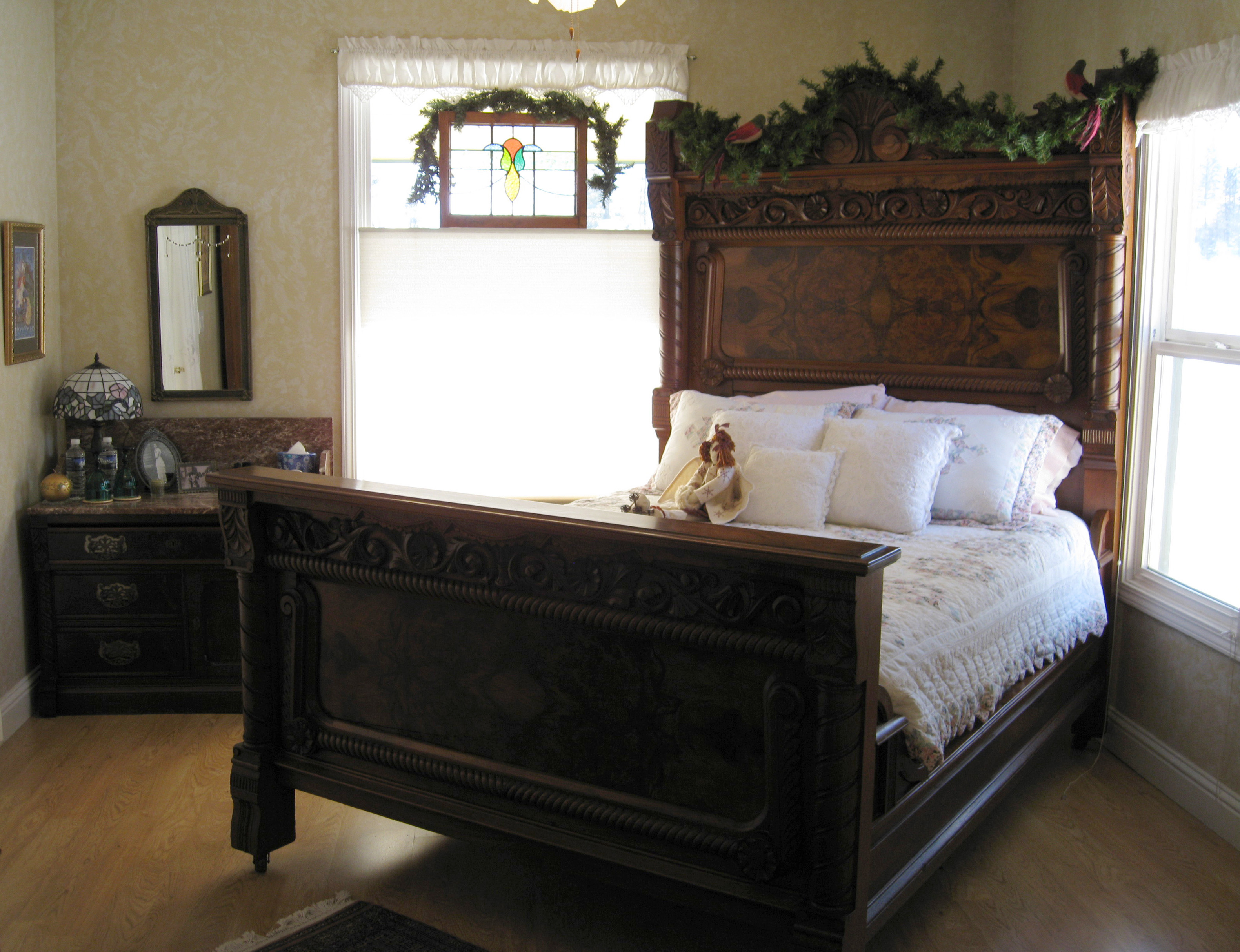 An antique bed, armoire, and other furnishings highlight Walk on the Wild Side B&B's Shadow Room.