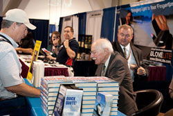 Hall of Fame pilot Bob Hoover signs copies of Forever Flying< at the 2010 AOPA Summit.