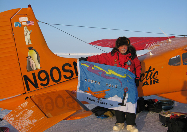 Art Mortvedt holds a flag at a Russian research station 20 miles from 90 degrees north, having overflown the pole April 6, 2013. Photo courtesy Art Mortvedt.