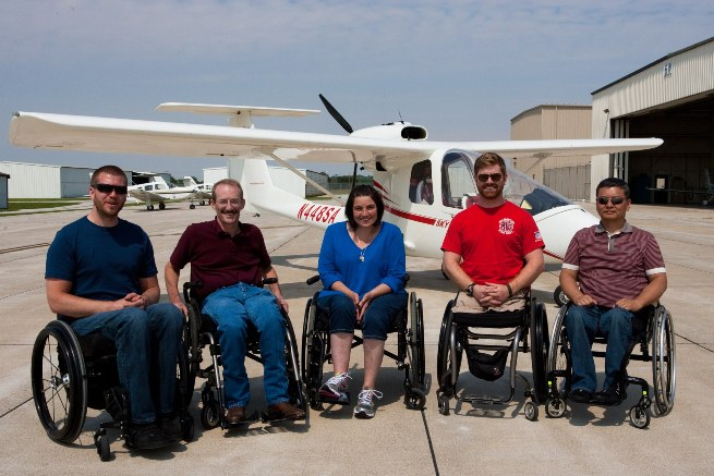 Able Flight awarded pilot wings to six new pilots at AirVenture. Shown here, left to right, are Warren Cleary, Dennis Akins, Dierdre Dacey, Andrew Kinard, and Young Choi. Not shown is Stephany Glassing.