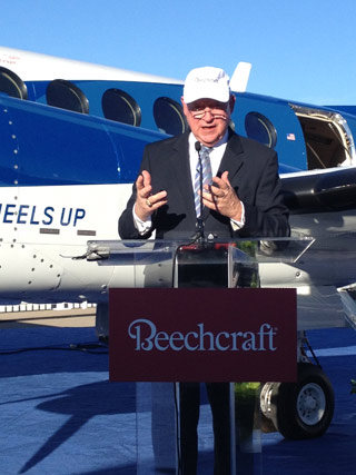 President and CEO Bill Boisture of Beechcraft addresses reporters at an NBAA press conference in front of the first King Air 350i to be delivered to Wheels Up, a new company providing low-cost access to business aircraft.