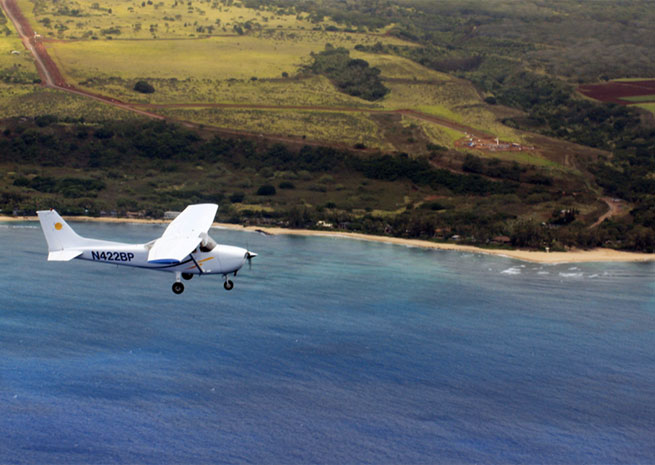 A Cessna 172 available from Barber's Point Flight School over the North Shore of Oahu.