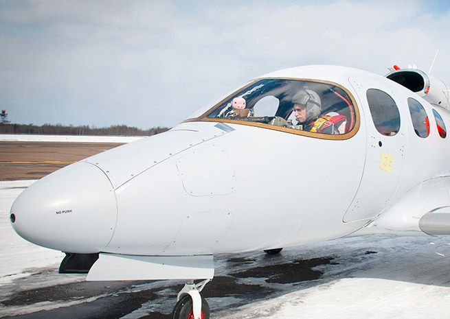 Chief Test Pilot Mike Stevens prepares for flight in the SF50. Cirrus Aircraft photo.